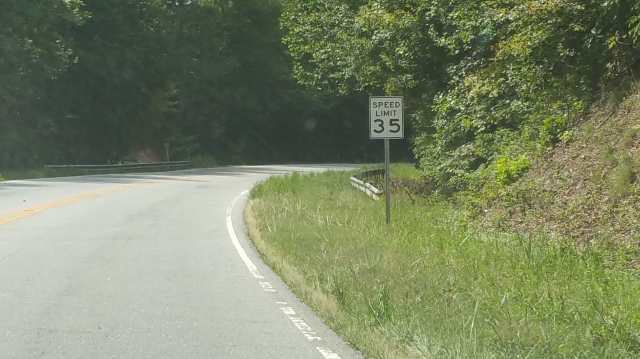 Again from the east of the school entrance in the middle of the big blind curve with the NEW 35mph sign. No school zone warning.